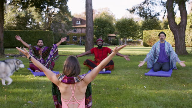 dog walking into outdoor yoga class - kent england stock videos & royalty-free footage