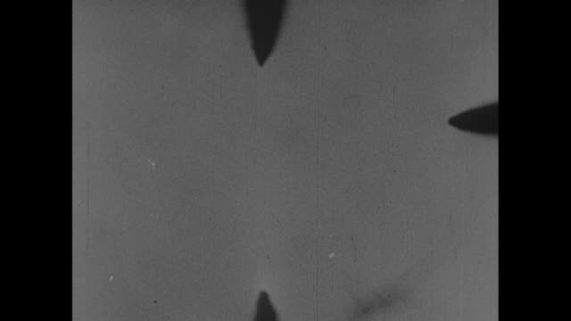 Dogfight with a Japanese fighter seen though viewfinder of American plane over New Guinea during World War II / Note exact day not known