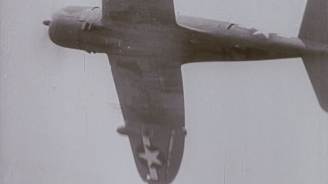 dogfights between fighters and strafing attacks, with aircraft coming apart and spiraling to crash below / normandy, france - d day stock videos & royalty-free footage