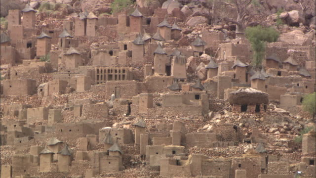 dogon village made out of mud at the bottom of the bandiagara escarpment in mali, west africa - hut stock videos & royalty-free footage