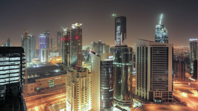 Doha city seen from skyscraper rooftop - motion controlled time-lapse