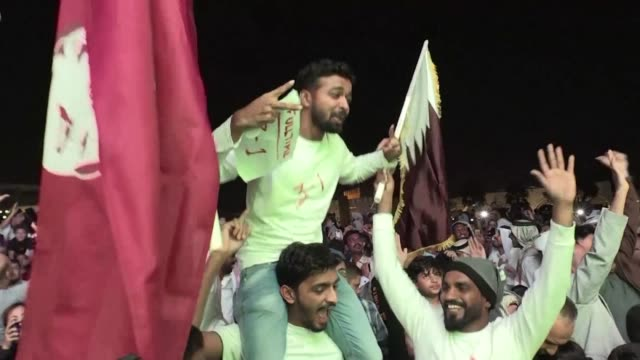 doha exploded in noisy celebration as jubilant qataris flooded the streets after the national football team's maiden asian cup triumph over japan - golfstaaten stock-videos und b-roll-filmmaterial