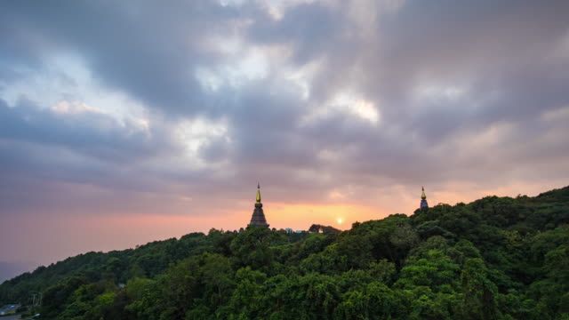 doi inthanon pagoda with dramatic sky and fog flowing against sunlight, chiang mai province, thailand - mayan stock videos & royalty-free footage
