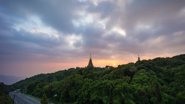 doi inthanon pagoda with dramatic sky and fog flowing against sunlight, chiang mai province, thailand - multicopter stock videos & royalty-free footage