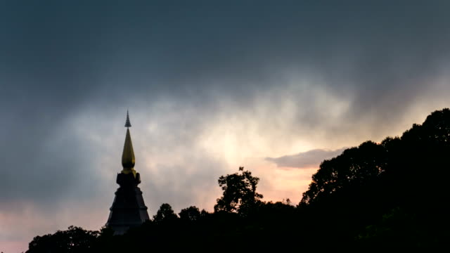 Doi Inthanon Pagoda with Dramatic Sky and Fog Flowing Against Sunlight, Chiang Mai Province, Thailand