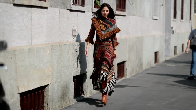 doina ciobanu wearing dress with pattern seen outside etro during milan fashion week spring/summer 2019 on september 21 2018 in milan italy - spring summer collection stock videos & royalty-free footage