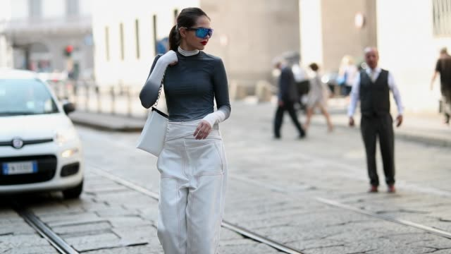 doina ciobanu wearing white high waist pants grey long shirt is seen outside sportmax during milan fashion week spring/summer 2019 on september 21... - modewoche stock-videos und b-roll-filmmaterial
