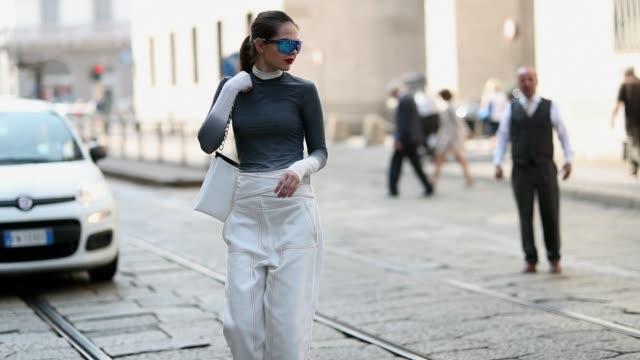 stockvideo's en b-roll-footage met doina ciobanu wearing white high waist pants grey long shirt is seen outside sportmax during milan fashion week spring/summer 2019 on september 21... - modeweek
