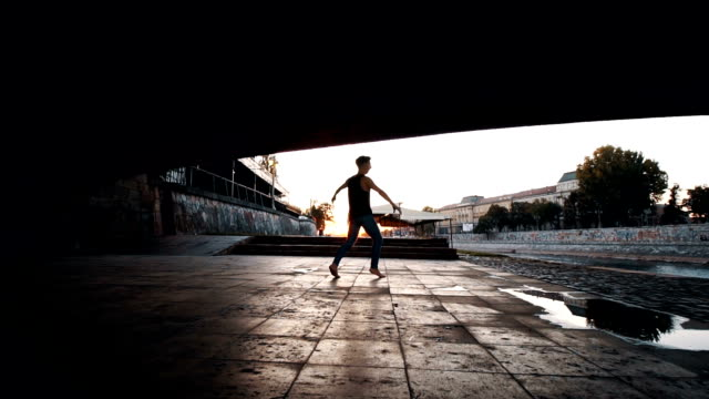doing a ballet moves under the bridge - modern dancing stock videos & royalty-free footage
