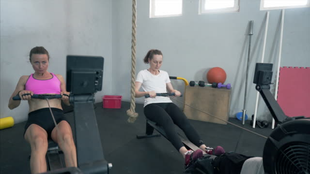 doing exercises on fitness machine. - rowing machine stock videos & royalty-free footage