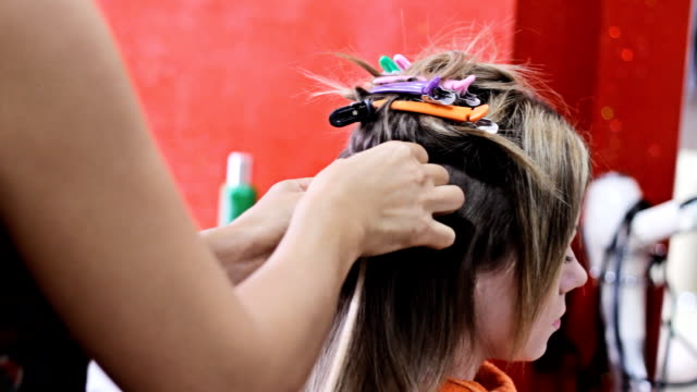 doing hair extensions - beauty salon stock videos and b-roll footage