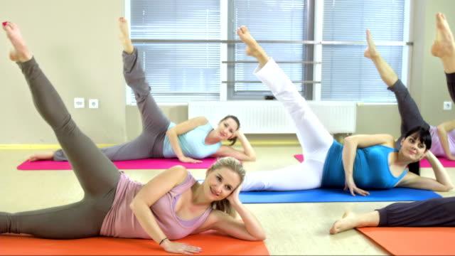 doing pilates side kicks - pilates stock videos and b-roll footage