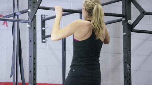 doing pull ups at the gym - fatcamera stock videos and b-roll footage