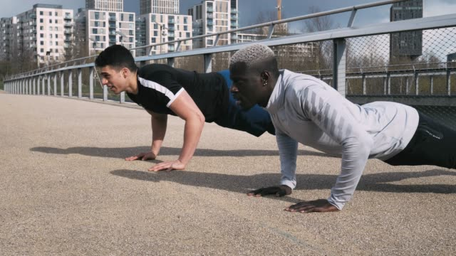 doing push ups before the rain - durability stock videos & royalty-free footage