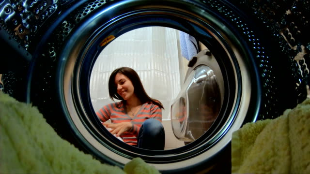 doing the laundry - launderette stock videos & royalty-free footage
