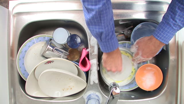 hd: doing the washing up - scrubbing stock videos & royalty-free footage
