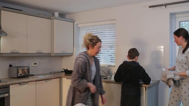 doing their daily chores - bathrobe stock videos & royalty-free footage