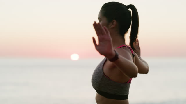doing yoga here because it adds to her inner peace - sportswear stock videos & royalty-free footage