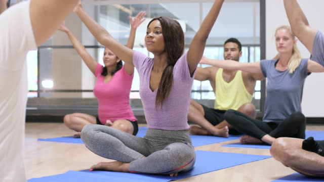 Doing Yoga in an Indoor Fitness Class
