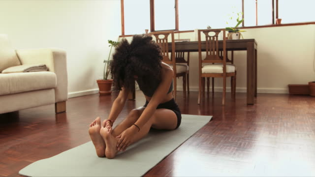 doing yoga is doing your own body a favour - doing a favour stock videos & royalty-free footage