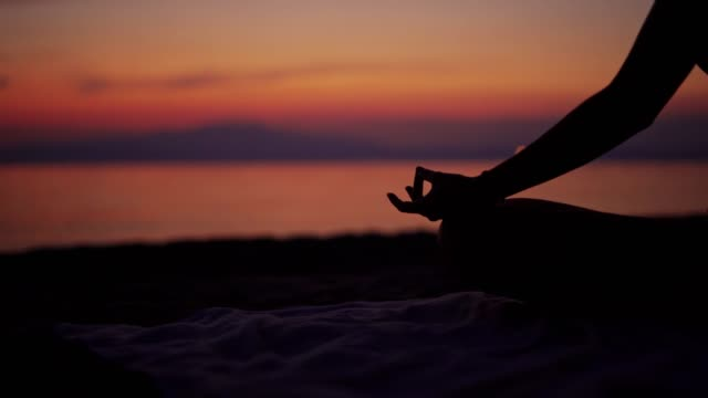 doing yoga on the beach - lotus position stock videos & royalty-free footage