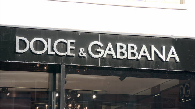 cu, dolce & gabbana sign on building exterior, madison avenue, new york city, new york, usa - dolce & gabbana stock videos & royalty-free footage