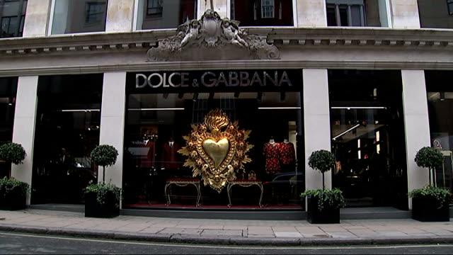 dolce & gabbana store; england: london: old bond street: ext gvs dolce & gabbana shop in old bond street - dolce & gabbana stock-videos und b-roll-filmmaterial