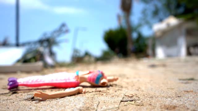 vídeos de stock e filmes b-roll de doll broken after tsunami - abandoned