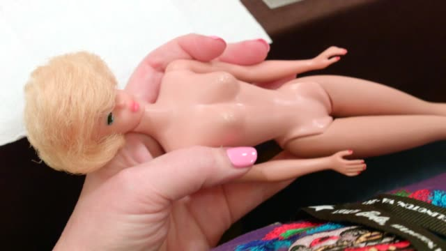 doll restorer arnaldo cardona shares secrets to painting new lips onto barbie dolls during the 'lip service' workshop fans gather for the 2015... - doll stock videos & royalty-free footage