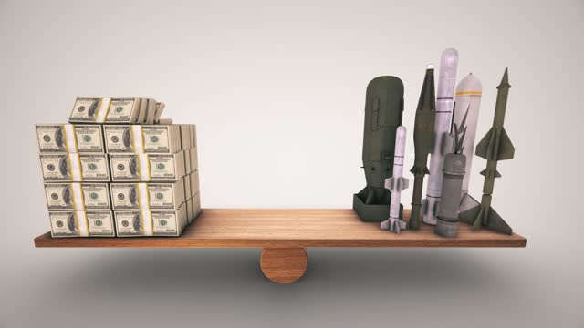 us dollar and military missile balancing on a wooden seesaw. animation slows down on both sides you can stop on the side you choose the concepts of global economy finance business balance interest rate target balance scales quantify comparison time money - stability stock videos & royalty-free footage
