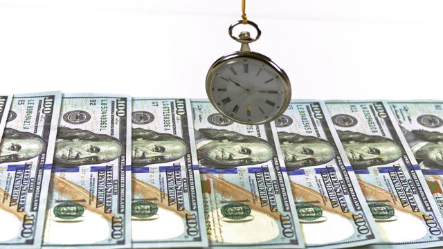 """""""100 us dollar banknotes and pocket watch, slow motion"""" - pocket watch stock videos & royalty-free footage"""