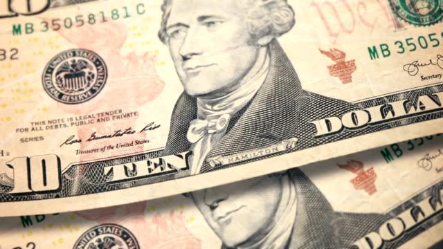 $10 dollar bill currency of the united states of america - banconota da 10 dollari statunitensi video stock e b–roll