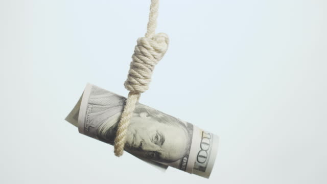 dollar bill hangman  devaluating money hanging on the rope - hanging execution stock-videos und b-roll-filmmaterial