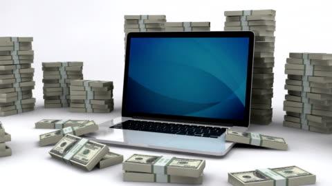 vídeos de stock e filmes b-roll de dólar das contas e computador portátil/fazer dinheiro online - making money
