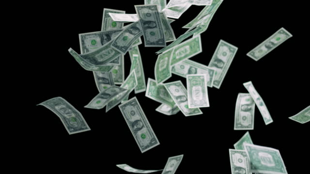 slo mo dollar bills falling down on black background - american one dollar bill stock videos & royalty-free footage