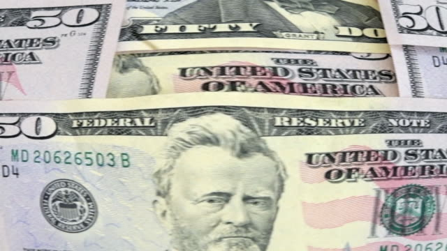 USD 50 dollar bills moving in front of the camera