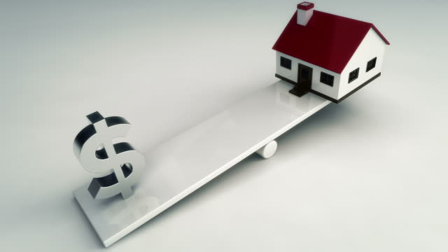Dollar sign and house on see saw
