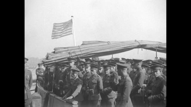 a dollar steamship comes in for a landing / vs american soldiers on board under an american flag and a dollar sign on a smokestack / americans leave... - 1910 stock videos & royalty-free footage