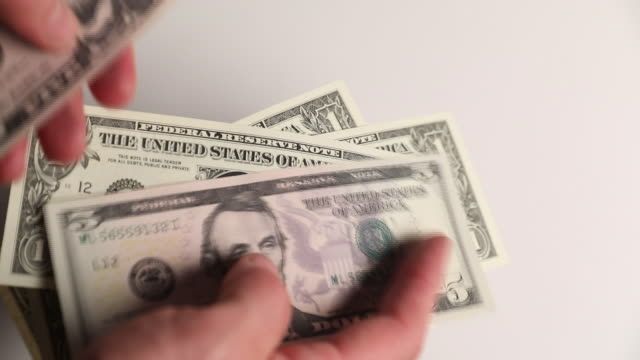 us dollars currency in london uk on tuesday october 2 2018 - banconota da 10 dollari statunitensi video stock e b–roll