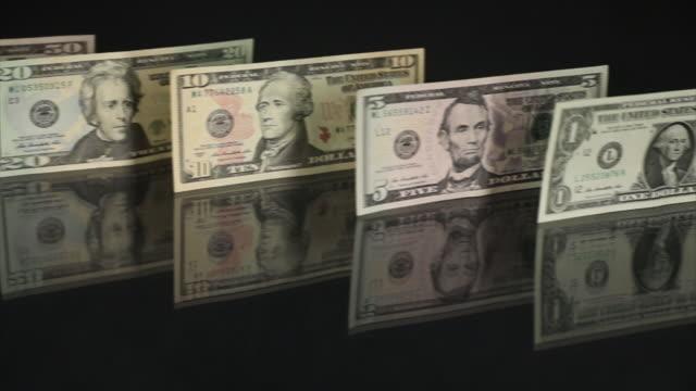 dollars currency in london, u.k. on tuesday, october 2, 2018. - twenty us dollar note stock videos & royalty-free footage