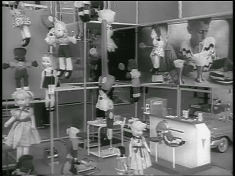 B/W 1959 dolls toys shelves in room of American Expo / Moscow / newsreel