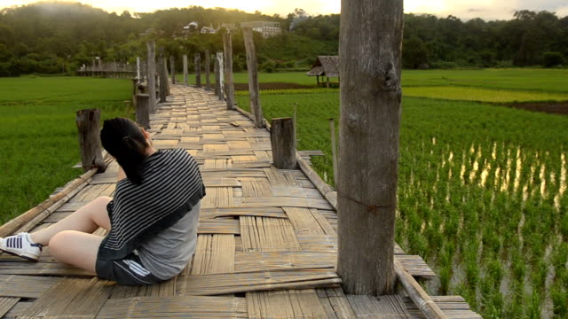 dolly: a beauty woman try to take photos of a bamboo bridge - mae hong son province stock videos and b-roll footage