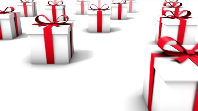 Dolly back diagonally from single a Gift Box revealing many