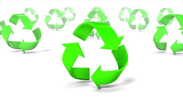 Dolly back diagonally from single Recycle symbol revealing many