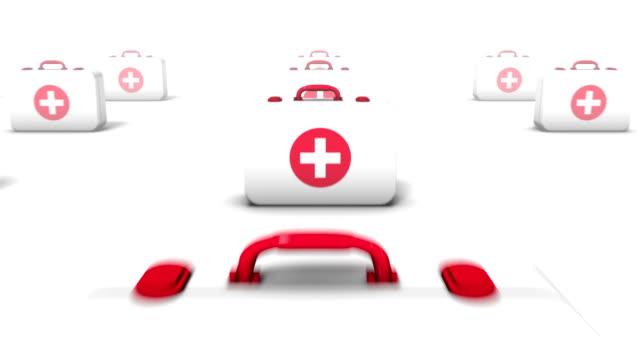 dolly back revealing many first aid kits - första hjälpen sats bildbanksvideor och videomaterial från bakom kulisserna