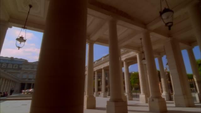 dolly behind columns facing courtyard at palais-royal / paris, france - 2002 stock videos & royalty-free footage