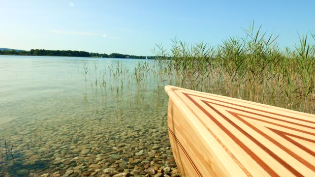 Dolly: Kanu am See Chiemsee, Bayern, im Sommer