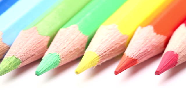 dolly: color pencils in a row - pencils in a row stock videos & royalty-free footage