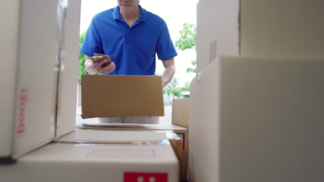 4k uhd dolly: courier delivery man store goods package in van after picking up from female merchant. inside car view point. - urgency stock videos & royalty-free footage