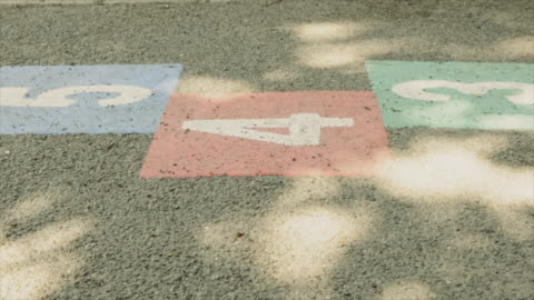 dolly: deserted school yard with hopscotch marks - abandoned stock videos & royalty-free footage